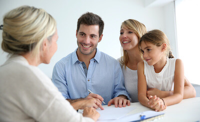 real estate agent talking with a family