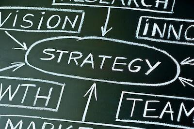 strategy written on a chalkboard